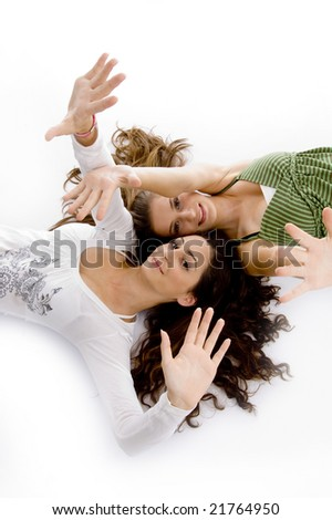 laying young females showing their palms on an isolated background - stock photo