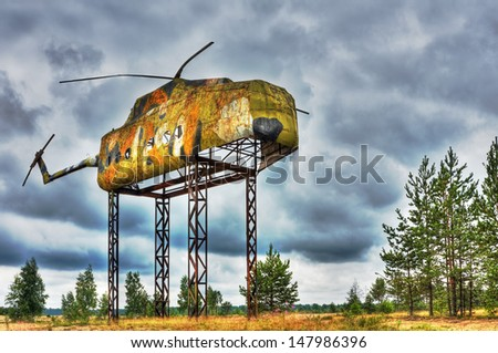 layout of the fuselage of an old helicopter on military range. Created with HDR - stock photo