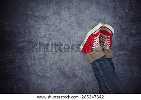 Lazy Young Teenage Woman Relaxing Concept, Red Sneakers on grunge Background - stock photo