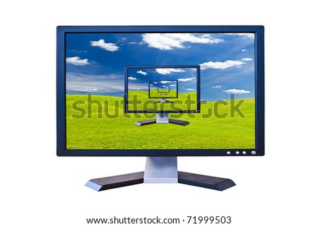 Lcd monitor on green grass meadow - stock photo