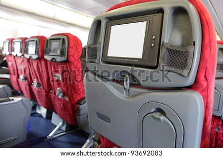 LCD monitor on Passenger Seat of airplane - stock photo