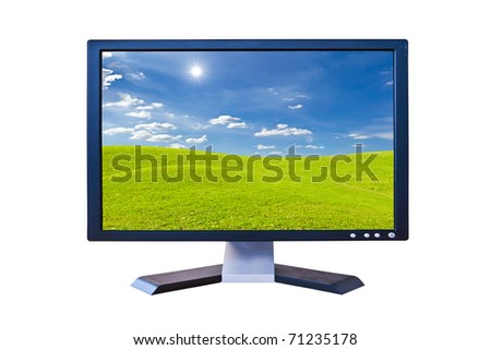 LCD Monitor with green grass meadow isolated - stock photo