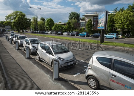 LE CHESNAY, FRANCE - MAI 25, 2015: Cars Autolib parked for rental next to Paris. Autolib is a french carsharing service of electric car.  - stock photo