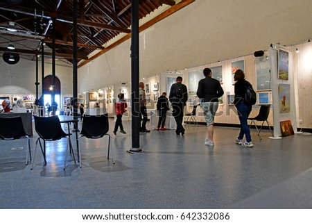 Le Croisic, France - april 12 2017 : exhibition in the old fish market