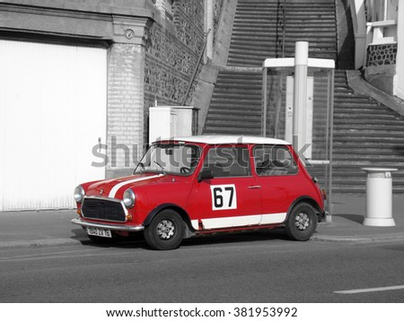 Le Havre, France - May 3 2009:  Mini Cooper Black and White Photography. Red Retro Car Austin Mini Cooper Parked on the Streets of Le Havre in the Normandy region - stock photo