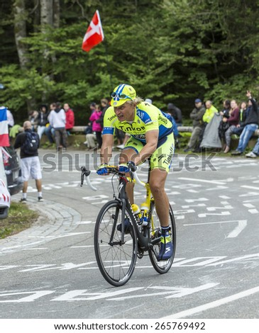 LE MARKSTEIN, FRANCE - JUL 13:Oleg Thinkov,the owner of Team Saxo Bank Thinkoff, riding a bicycle on Le Markstein before the apparition of the peloton in the stage 9 of Le Tour de France 2014.