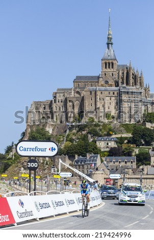 LE MONT SAINT MICHEL,FRANCE-JUL 10:The cyclist Brett Lancaster from Orica-GreenEDGE Team cycling during the stage 11 of Le Tour de France 2013, a time trial between Avranches and Mont Saint Michel - stock photo