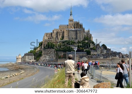 LE MONT SAINT MICHEL, FRANCE - MAY 30: View on the ancient village of Mont Saint Michel, old traditional colorful houses and its roofs. Le Mont Saint Michel, France - May 30, 2014 - stock photo
