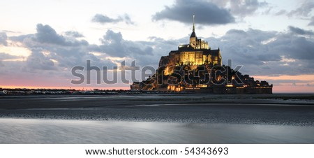 Le Mont-Saint-Michel in the twilight, panoramic view - stock photo