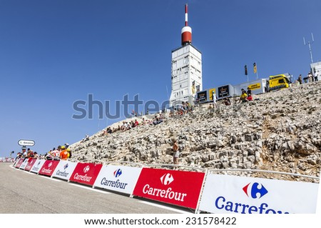 LE MONT VENTOUX, FRANCE-JUL 14:People start to keep their places on the road to Mount Ventoux many hours before the apparition of the cyclists in the stage 15 of Le Tour de France on July 14 2013. - stock photo