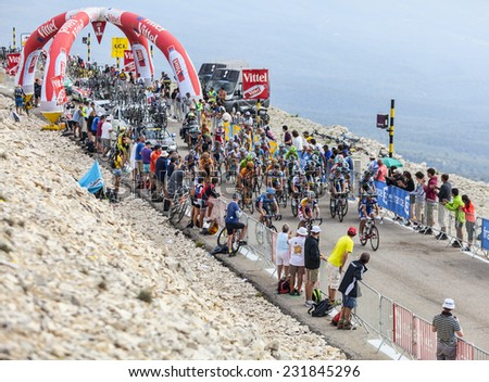 LE MONT VENTOUX, FRANCE-JUL 14: The peloton passing the 1 Km milestone on the road to the top of Mont Ventoux during the stage 15 of Le Tour de France on July 14 2013. - stock photo