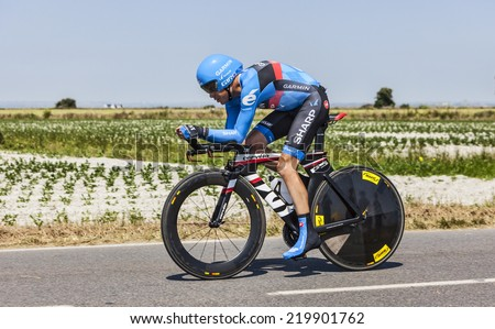 LE PONT LANDAIS,FRANCE-JUL 10:The American cyclist Tom Danielson from Garmin-Sharp Team cycling during the stage 11(time trial Avranches -Mont Saint Michel) of Le Tour de France on July 10, 2013 - stock photo
