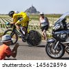 LE PONT LANDAIS,FRANCE-JUL 10: Yellow Jersey (Chris Froome, Great Britain) cycling in front of the Mont Saint Michel monastery, during the stage 11 of Le Tour de France on July 10, 2013 - stock photo