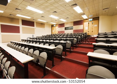 leacture room with many chairs. - stock photo