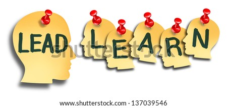 Lead and learn education as a business training concept with a group of office notes with red thumbtacks shaped as a human head on a white background. - stock photo