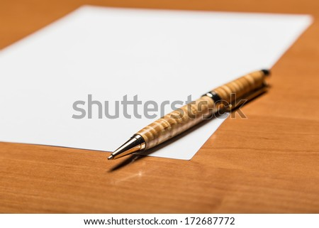 Lead pencil and notebook on white table