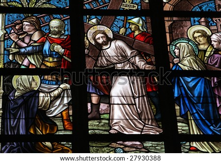 Leaded glass window in church of Alsemberg (close to Brussels in Belgium), made in 1895. Depiction of Jesus on the Via Dolorosa. - stock photo