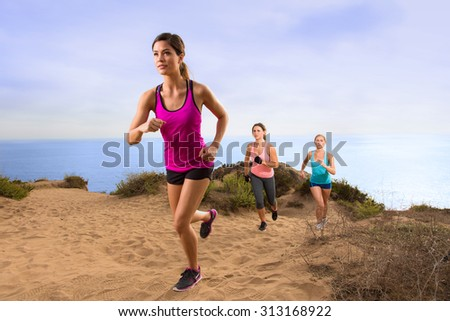 Leader jogger running uphill extreme workout fitness in shape weight loss exercise team row modern  - stock photo