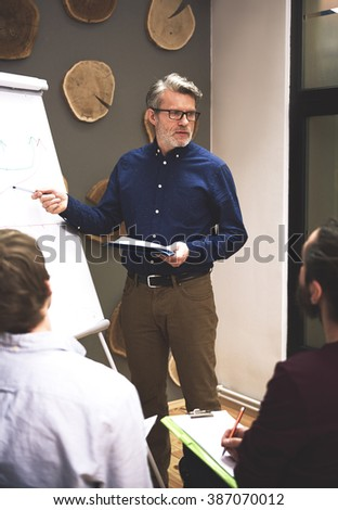 Leader showing what is the most important in business - stock photo