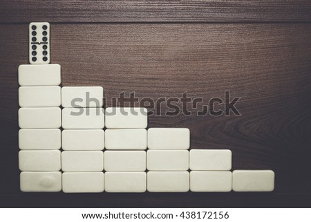 leadership concept. domino pieces forming stair over wooden background - stock photo