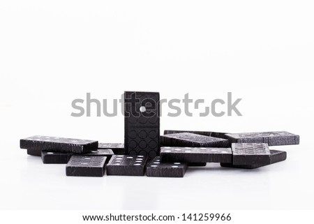 Leadership concept, domino standing out from the crowd, isolated on white background. - stock photo