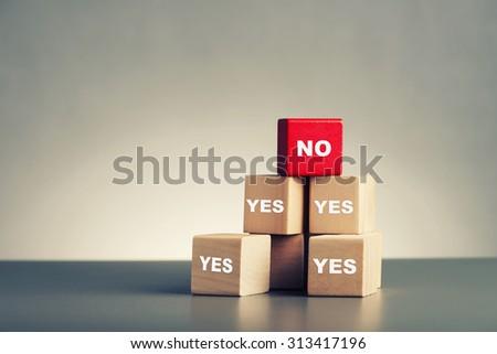 leadership concept pile of wood blocks on grey background - stock photo