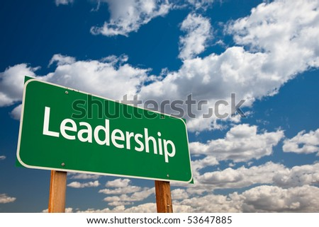 Leadership Green Road Sign with Copy Room Over The Dramatic Clouds and Sky. - stock photo