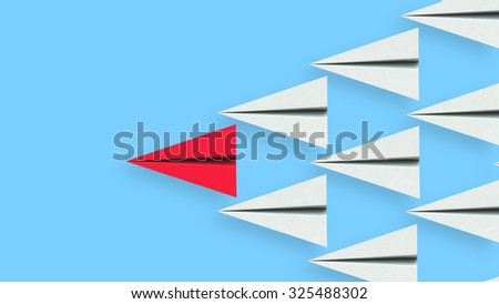 Leadership illustration concept of a red paper plane leading a team of followers. Clipping path included for easy selection. - stock photo