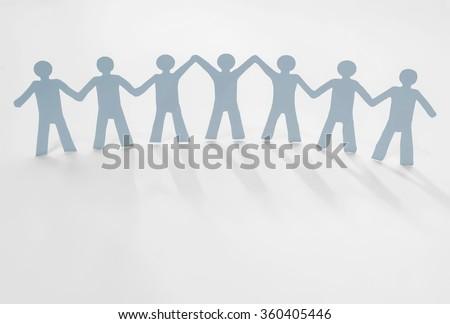 leadership in team (paper cut) - stock photo