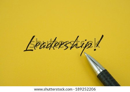 Leadership note with pen on yellow background - stock photo