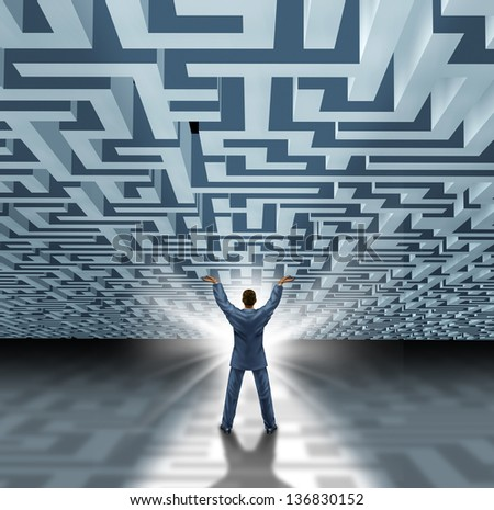 Leadership skills with a successful business man lifting a three dimensional maze or labyrinth as a business concept of overcoming adversity and breaking free with a new creative solution. - stock photo