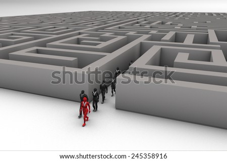 Leadership through a Maze. A Leader directs her team out of a Maze. - stock photo