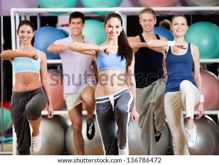 Leading healthy lifestyle people at the gym in a fitness class - stock photo
