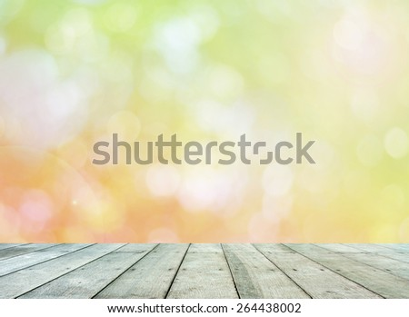 Leaf bokeh background with wooden paving. - stock photo