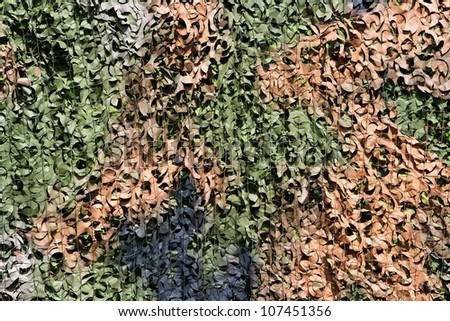 Leaf camouflage net background - stock photo