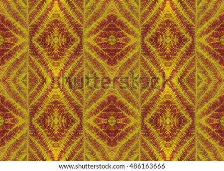 Leaf texture, colorful pattern background for scrapbook, top view. Collage with mirror reflection. Seamless kaleidoscope montage for cushion, blanket, pillow, plaid, tablecloth, cloth, bed cloth