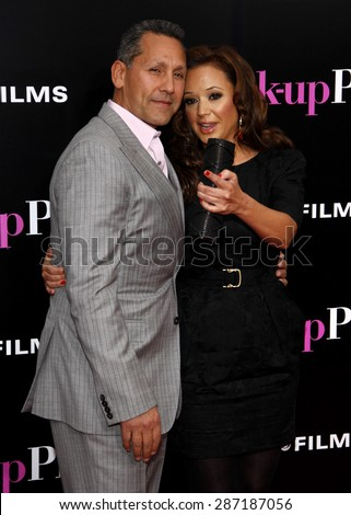 Leah Remini and Angelo Pagan at the Los Angeles premiere of 'The Back-Up Plan' held at the Regency Village Theatre in Westwood on April 21, 2010.  - stock photo