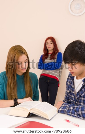Leaning against the classroom wall and feeling jealous - stock photo