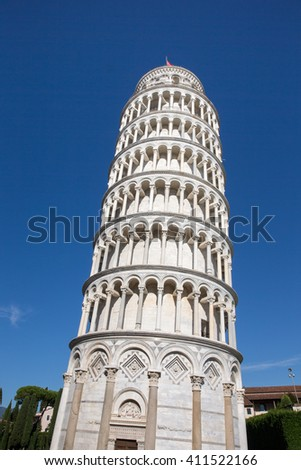 Leaning Tower of Pisa in Tuscany, Italy.  Dramatic view from base with a vibrant blue sky.  Concepts could include architecture, travel, European culture, others. - stock photo