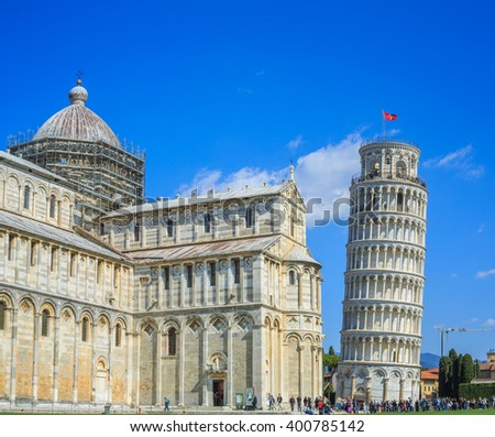 leaning Tower of Pisa is the campanile, or freestanding bell tower, of the cathedral of the Italian city of Pisa, known worldwide for its unintended tilt. - stock photo