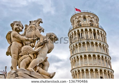 Leaning Tower of Pisa with angels statue, Tuscany - Italy - stock photo