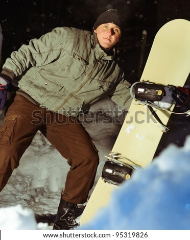 Leaning with snowboard - stock photo