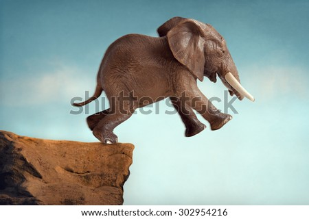 leap of faith concept elephant jumping into a void - stock photo