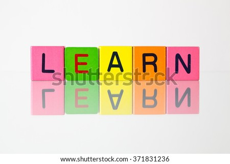 Learn - an inscription from children's wooden blocks - stock photo