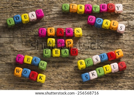 Learn and Lead text on a wooden background - stock photo