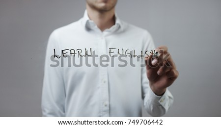 Learn english , Man Writing on Glass