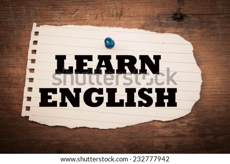 Learn English phrase on paper and wood  - stock photo