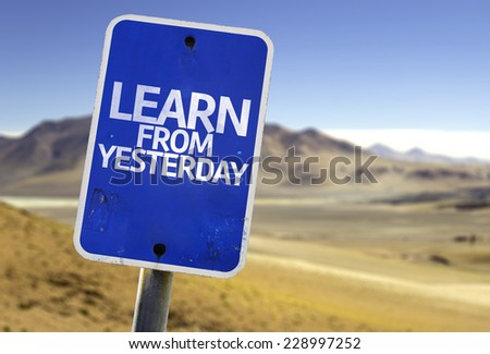 Learn From Yesterday sign with a desert background - stock photo