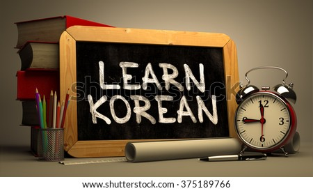 Learn Korean Handwritten on Chalkboard. Time Concept. Composition with Chalkboard and Stack of Books, Alarm Clock and Scrolls on Blurred Background. Toned Image. 3D Render. - stock photo