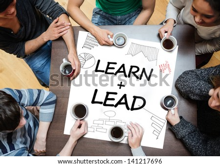 Learn plus lead written on a poster with drawings of charts during a brainstorm - stock photo